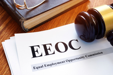 EEOC equal employment opportunity commission report and gavel. Stock Photo