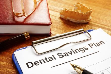 Dental Savings Plan with clipboard on desk. Reklamní fotografie