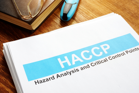 HACCP Hazard Analysis and Critical Control Points report on table. Stok Fotoğraf