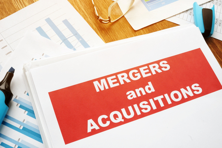 Mergers and Acquisitions M&A agreement and business papers. Фото со стока