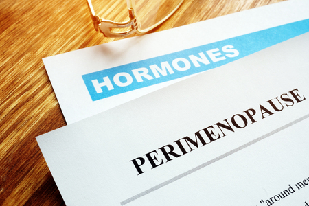 Perimenopause and menopause concept. Documents about hormones. Stock Photo