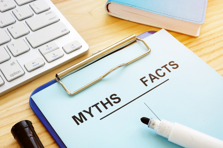 Myths and facts list with pen. Fake news concept.