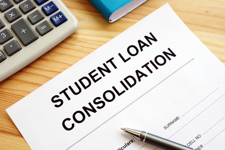 Student Loan Consolidation application, calculator and pen.