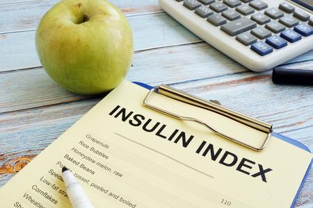 Insulin index list with clipboard on wood. Stok Fotoğraf