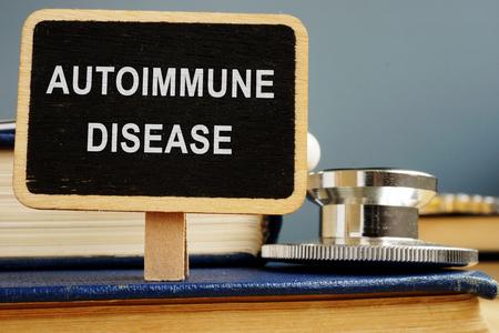 Autoimmune disease concept. Stethoscope and books.
