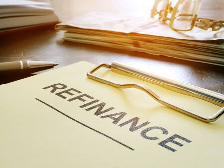 Refinance concept. Stack of business documents on table.