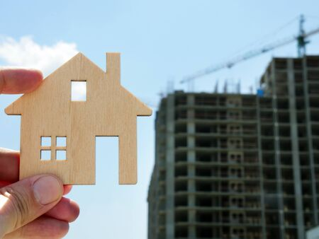 Buy property or mortgage concept. Model of home and House building. Stock Photo