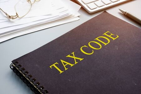 Tax code and financial documents in the office. Archivio Fotografico