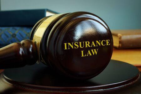 Insurance law concept. Wooden gavel in the court. Standard-Bild
