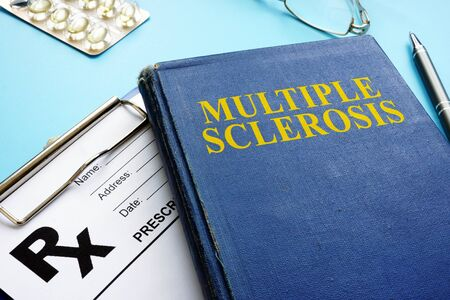 Multiple sclerosis MS book and prescription and pen.