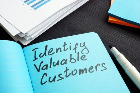 Sign on a page Identify valuable customers RFM Segmentation concept. Archivio Fotografico