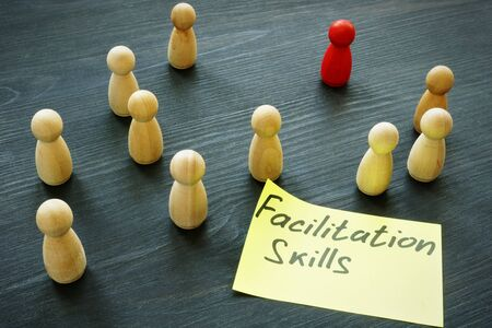 Facilitation skills concept. Wooden figurines as symbol of teamwork. Stock Photo