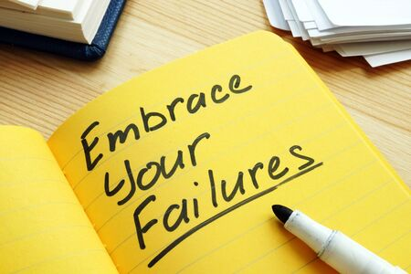 Embrace your failures written by pen on the page.
