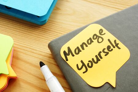 Manage yourself quote on a piece of paper. Self Leadership.