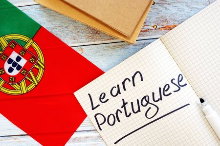 Learn Portuguese language concept. Flag and notebooks.