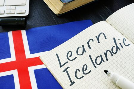 Learn Icelandic written on a page and flag. 스톡 콘텐츠