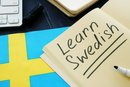 Learn Swedish language sign and book.