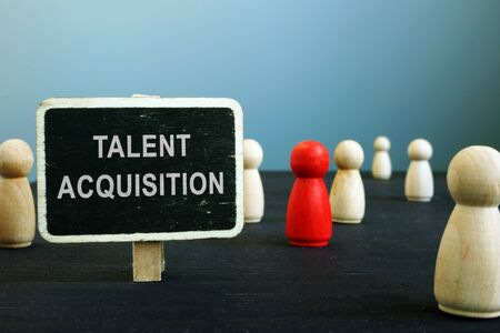 Talent acquisition strategies sign and wooden figurines. HR management concept. Stock fotó