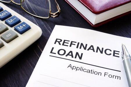 Refinance loan application form and pen.
