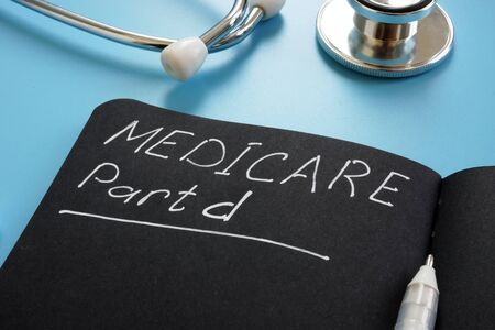 Medicare part d sign on the black page and stethoscope. 写真素材 - 129813865