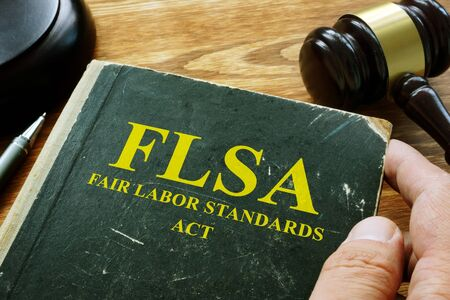 Man holds FLSA fair labor standards act.