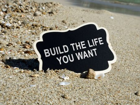 Build the life you want sign on the wooden plank.