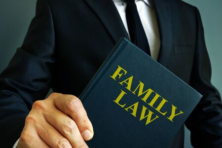 Family law book about divorce in the hands of a man.
