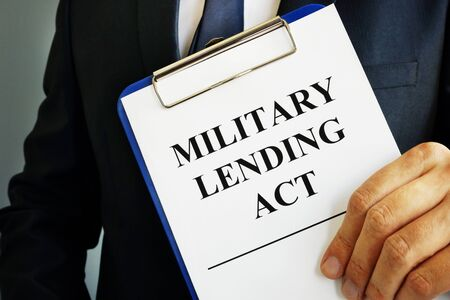 Man is holding Military Lending Act MLA.