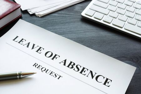 Leave of absence request on the table. Stockfoto - 130722087