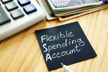 Flexible spending account FSA sign on a black piece of paper. Stock fotó