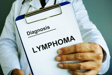 Doctor is holding Diagnosis Lymphoma.