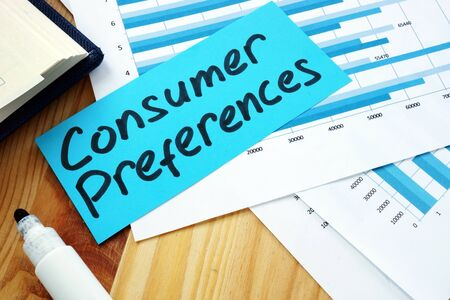 Measuring Consumer Preferences concept. Stack of papers with charts.