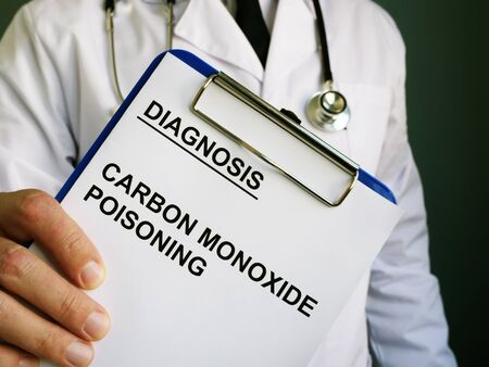 Doctor holds diagnosis Carbon monoxide poisoning.