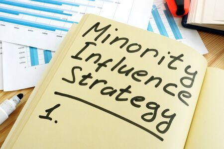 Minority Influence Strategy sign and working papers. Imagens