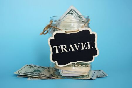 Savings for vacation and travel. Jar with plate and money.