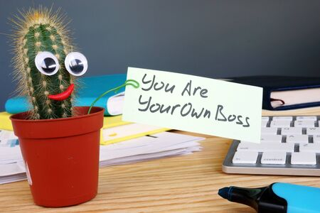 You are your own boss sign on the desk.