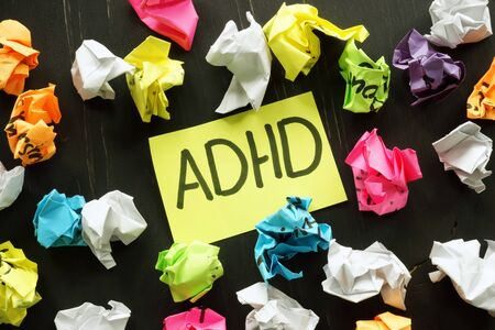 ADHD Attention deficit hyperactivity disorder sign and paper balls.