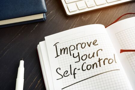 Improve Your Self-Control sign in the red notebook.