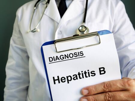 Hepatitis B diagnosis in the hands of a doctor.
