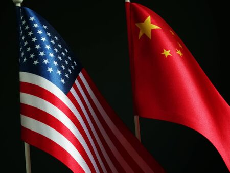 China and USA flags. Trade war and negotiation concept.