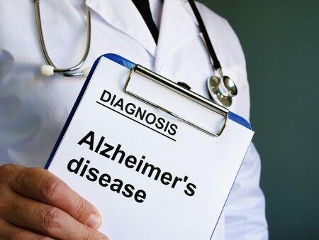 Diagnostic form with Alzheimers disease in the hands.