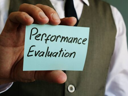 Performance Evaluation written on a piece of paper.