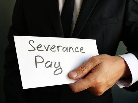 Severance Pay written on envelope with money.
