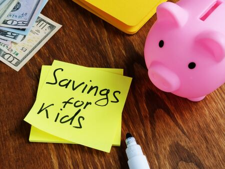 Savings for kids sign and pink piggy bank.