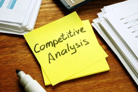 Competitive Analysis report and stack of business papers.
