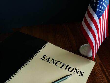 American sanctions and USA flag on table.