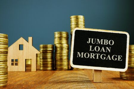 Jumbo Loan mortgage inscription and stacks of coins. 版權商用圖片