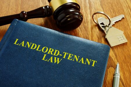 Landlord Tenant Law book and key from home.