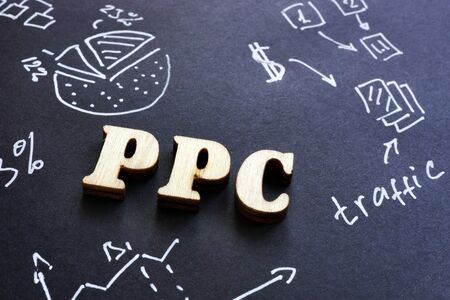 PPC pay per click sign on black paper.