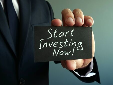 Start Investing Now sign in the hands.